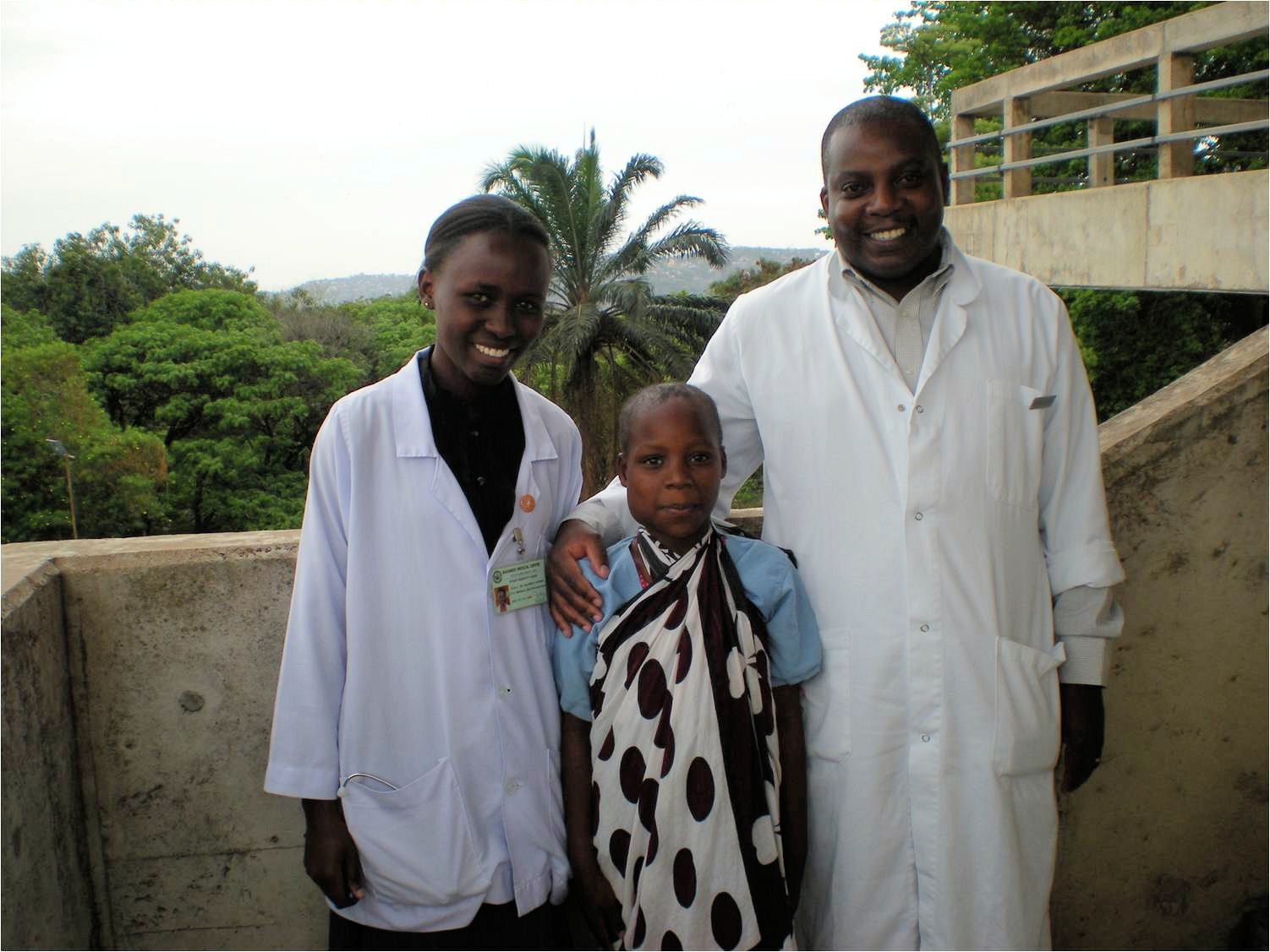 Dr-Nestori-and-young-patient-at-Bugando-Med-Cent.jpg